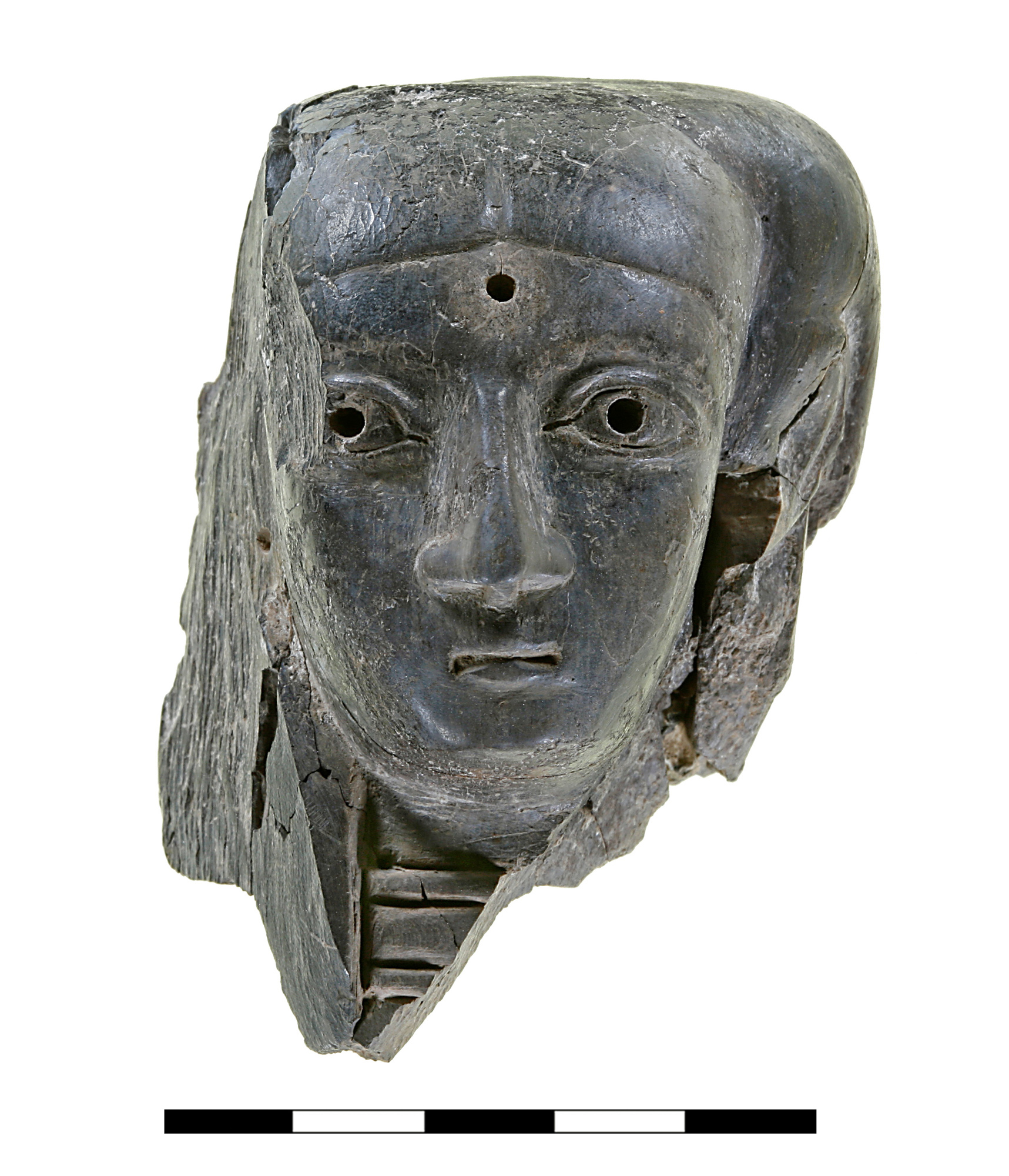 Head of a Canaanite official  made of ivory, found in the Ceremonial Precinct, Building 7050. Only part of this head, which may have belonged to an anthropomorphic statuette, remains, including the face, the left ear, the neck and part of the headdress. Its fragmentary state makes it difficult to establish whether it belonged to a standing or seated figure or perhaps even to a composite creature, such as a sphinx. It is most likely dated to the Late Bronze Age.