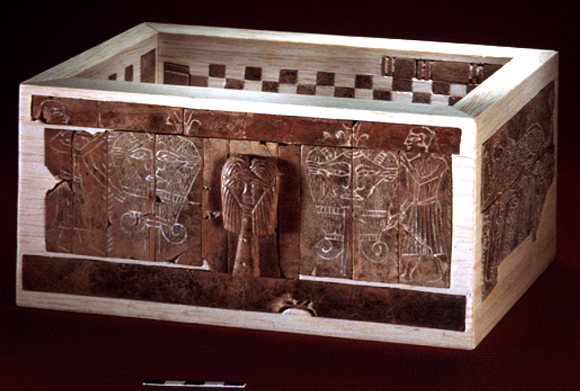 A jewelry box decorated with bone plaques engraved with various figures, found in the Late Bronze Age Ceremonial Precinct