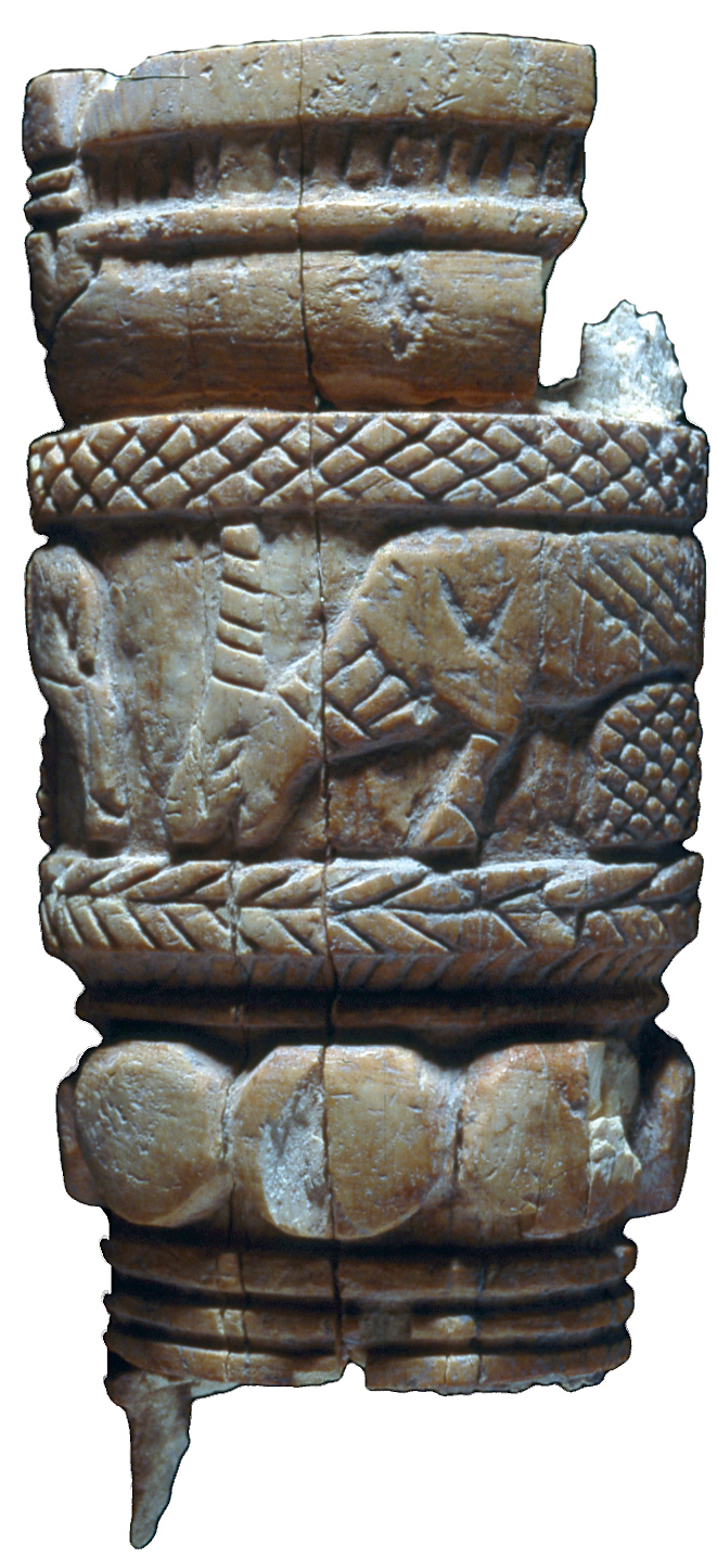 A carved bone handle depicting grazing horned animals, dated to the Iron Age