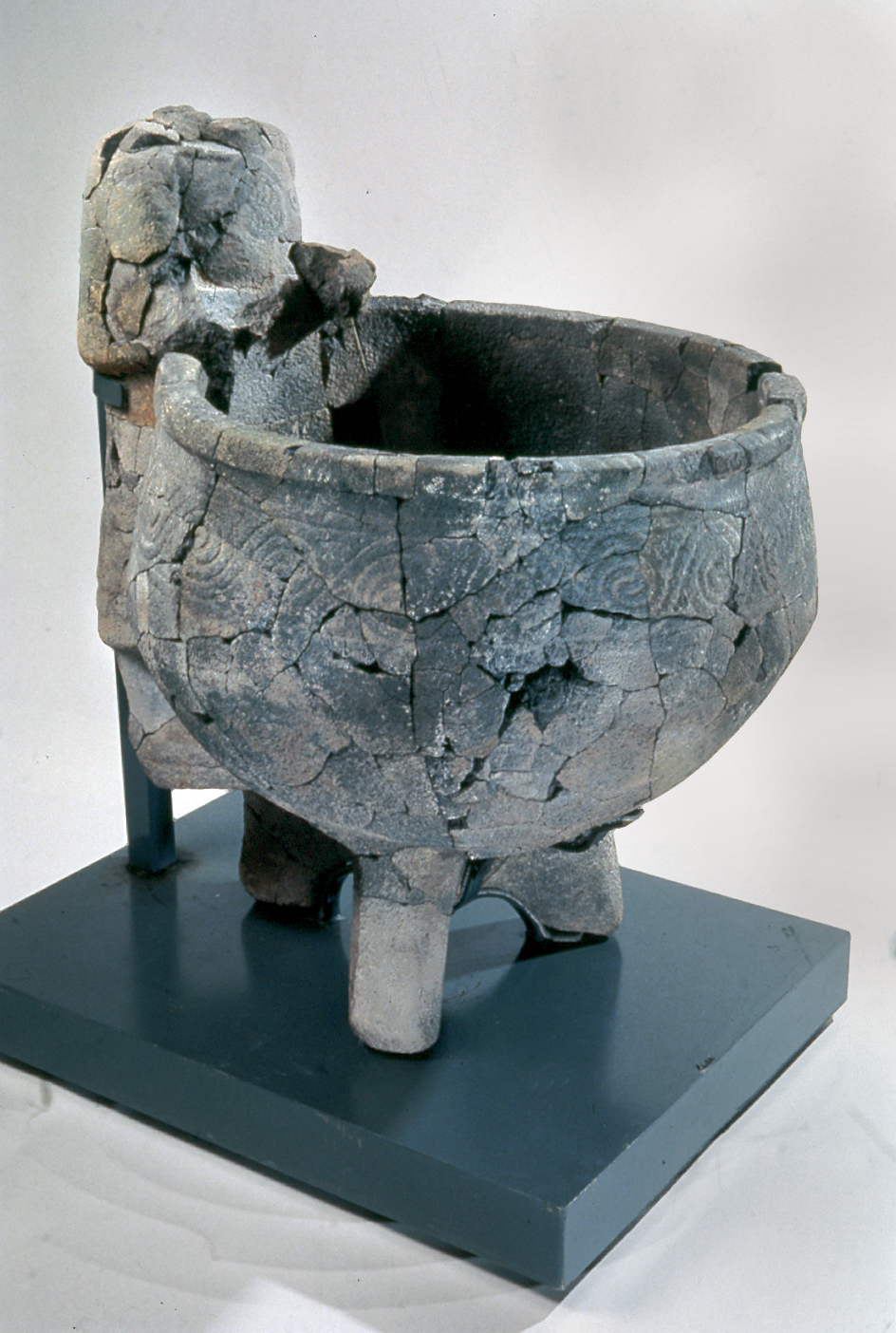 A basalt statue and a large basin, found in the Late Bronze Age Ceremonial Precinct